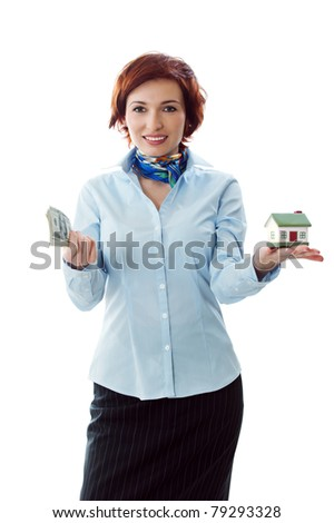 Beautiful young woman holding money and house model over white - real estate loan concept