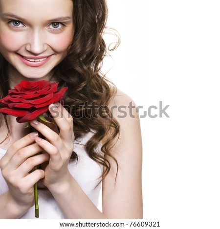 beautiful young woman holding red rose. Space for text.