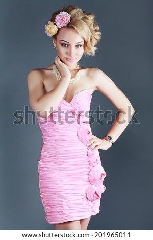 beautiful young woman in a beautiful pink prom dress