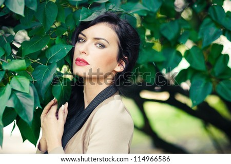 beautiful young woman in a city park