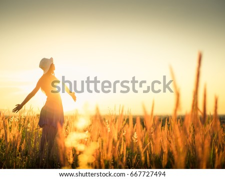 Beautiful Young Woman in a field.