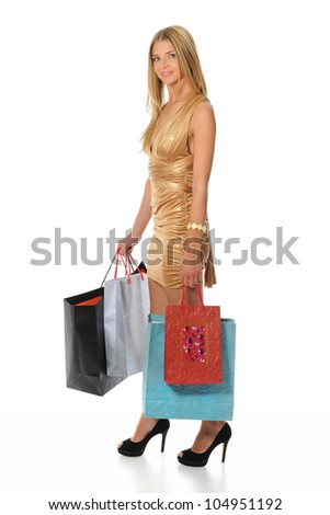 beautiful young woman in a full-length with shopping bags. Isolated on white background