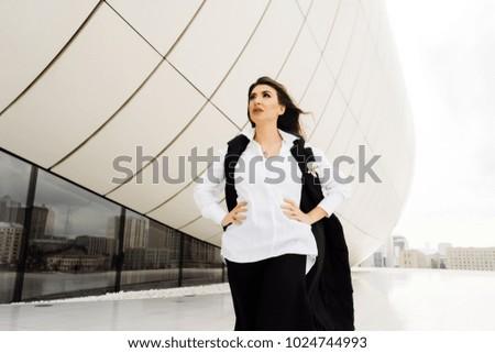 beautiful young woman in a white shirt walking around the city of Baku
