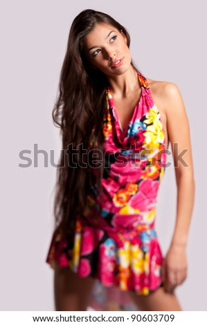 beautiful young woman in an elegant dress on the isolated background