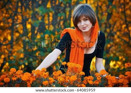 Beautiful young woman in autumn garden