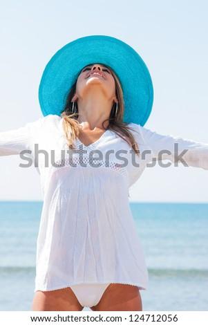 Beautiful young woman in bikini on the beach