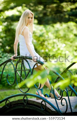 Beautiful young woman in blooming garden