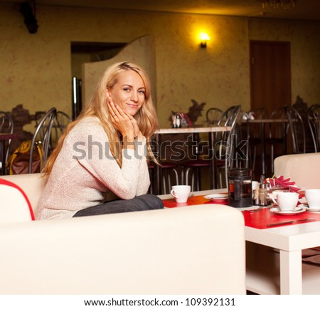 Beautiful young woman in cafe
