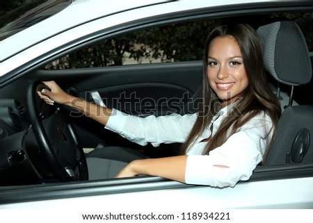 beautiful young woman in car