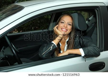 beautiful young woman in car #121516963