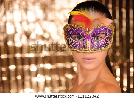 Beautiful young woman in carnival mask