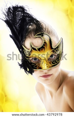 Beautiful young woman in carnival mask. Isolated over abstract background.