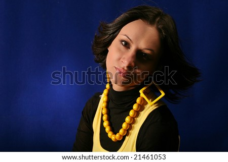 Beautiful young woman in dark on blue