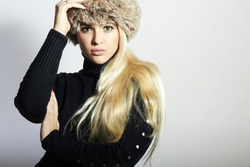 Beautiful Young Woman in Fur Hat. Pretty Blond Girl. Winter Fashion Beauty.Healthy hair