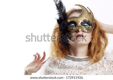 Beautiful young woman in gold mysterious venetian mask. Fashion photo