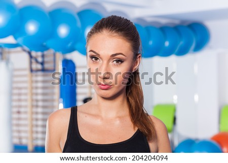 Beautiful young woman in gym. Gym shot. Crossfit hall