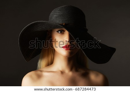 4be047e038e Beautiful young woman in hat. fashion beauty blonde girl in hat  687284473  · Closeup portrait of beautiful young woman with red lips wearing big ...