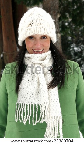 beautiful young woman in hat, scarf and coat