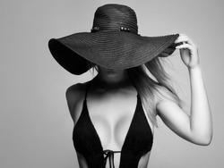 Beautiful young woman in hat. summer fashion beauty blonde girl. sexual model in bikini