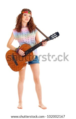 beautiful young woman in hippie outfit plays on acoustic guitar. Isolated on white