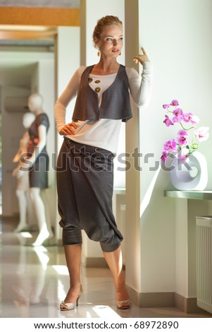 Beautiful young woman in interior