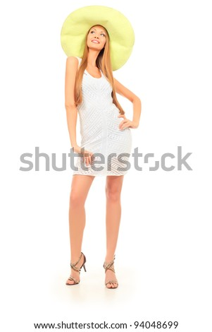 Beautiful young woman in light summer dress posing  over white.