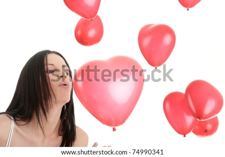 Beautiful young woman in lingerie with red heart balloon on a white background (love and valentines concept)