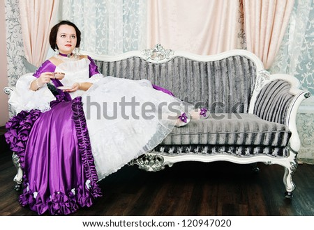 Beautiful young woman in medieval dress - stock photo