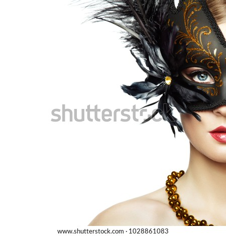 Stock Photo Beautiful young Woman in Mysterious Black Venetian Mask. Fashion photo. Masquerade Mask with Black Feathers