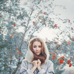 Beautiful young woman in mystical woods