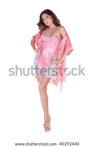 04a5beec26 Beautiful young woman in pink nightgown isolated over white