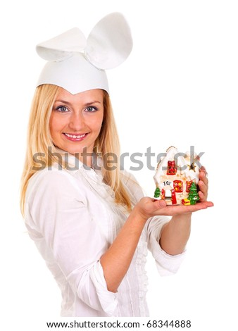 Beautiful young woman in rabbit hat holds candle house
