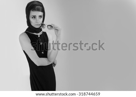 beautiful young woman in retro style . copy space.