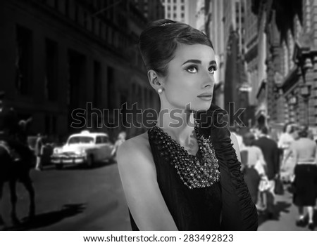 beautiful young woman in retro style in old town