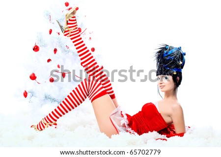 Beautiful young woman in Santa Claus clothes isolated over white background. Christmas.