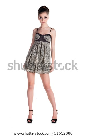 Beautiful young woman in short dress isolated on white