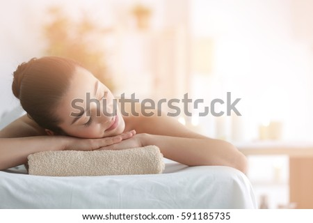 Beautiful young woman in spa salon - Shutterstock ID 591185735