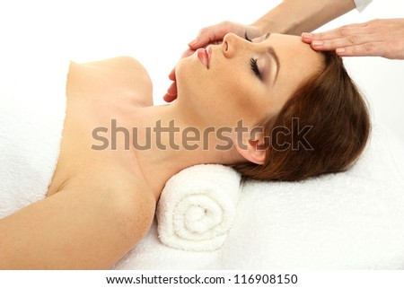 beautiful young woman in spa salon getting massage, isolated on white