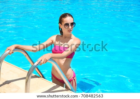 3b4217bcd55 Free photos Beautiful young woman stepping out of swimming pool ...