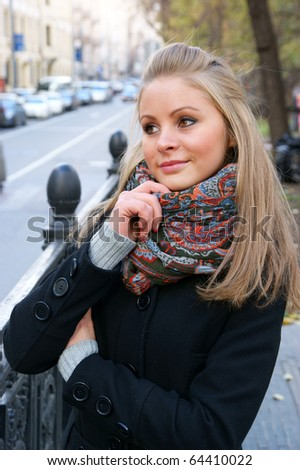 Beautiful young woman in the city street