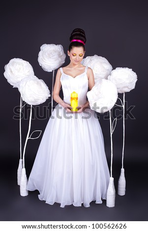 Beautiful young woman in the image of a fairy bride. A series of photos in my portfolio. Studio shot.