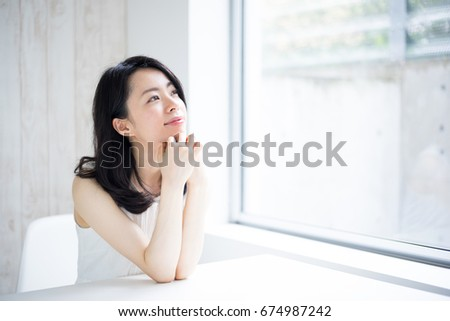 Beautiful Young woman in the room #674987242