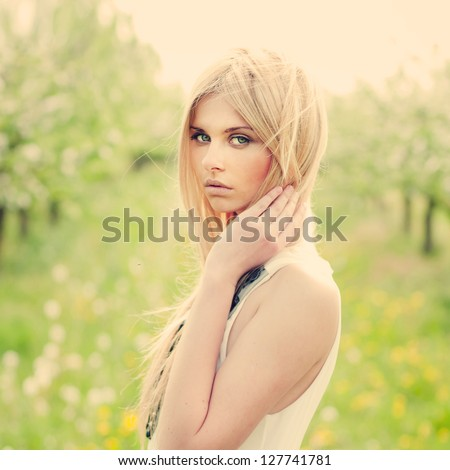 beautiful young woman in the summer garden