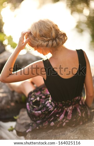 beautiful young woman in the summer garden - stock photo