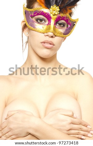 Beautiful young woman in venetian mask by white isolated background
