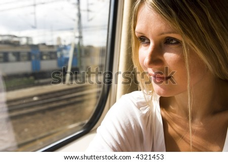 beautiful young woman in vintage train