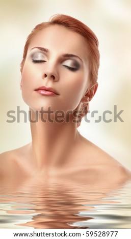beautiful young woman in water - stock photo