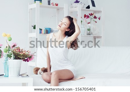 Beautiful young woman in white interior