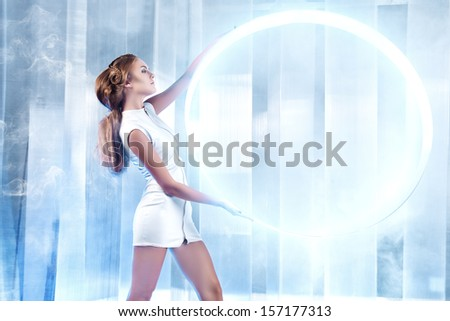 Beautiful Young Woman In White Latex Costume With Futuristic Hairstyle And Make-Up. Sci-Fi Style.