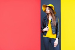 Beautiful young woman in yellow hat